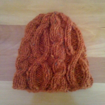 Knitted cap with cables